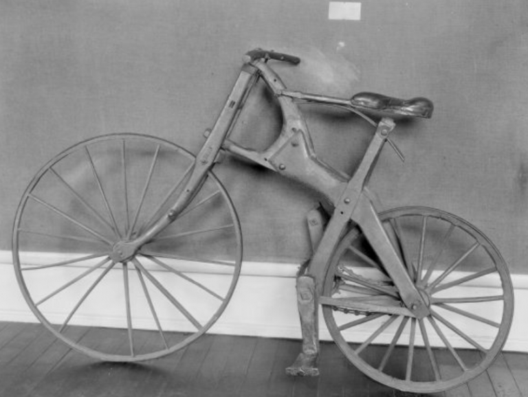 a black and white picture of the Crab Tree Special bicycle, showing the wooden frame and wheels